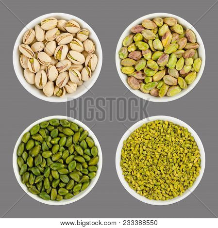 Pistachios In White Porcelain Bowls. Roasted Pistachio Seeds In Shells And Shelled. Green Dried Frui