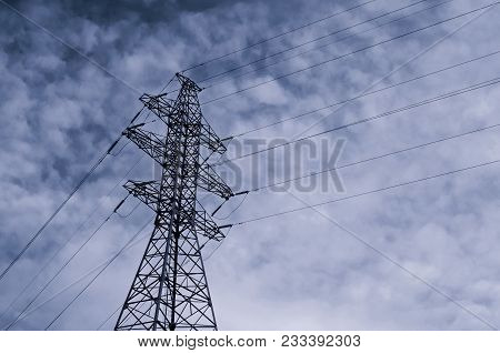 High Voltage Power Transmission Line. Industrial Background With High Voltage Tower On The Backgroun