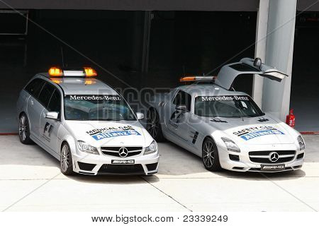 SEPANG, MALAYSIA - APRIL 8: The FIA's Medical Car and Safety Car park on standby at the control centre throughout the Petronas Malaysian F1 Grand Prix on April 8, 2011 in Sepang, Malaysia.
