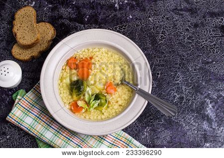 Thick Clear Soup With Pasta And Vegetables In Dish. Selective Focus.