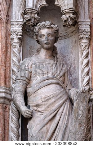 VENICE, ITALY - MAY 28: Statue on the Porta della Carta, detail of the Doge Palace, St. Mark Square, Venice, Italy, UNESCO World Heritage Sites on May 28, 2017.