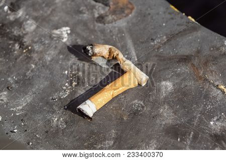 The Rest Of Many Cigarette Butts In The Dirty Ashtray. A Lot Of Cigarette Butts. Reason Of Lung Canc