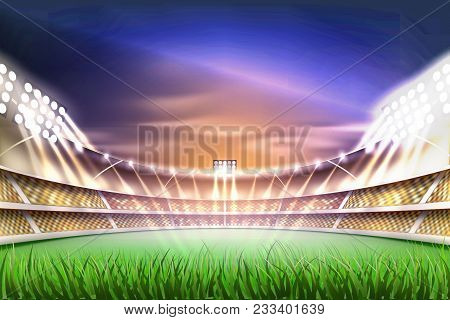 Football Soccer Stadium Tribune Backgroud With Realistic Green Grass Field Playground, Illuminated B