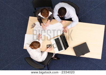 Managers Talking About Details Of Project In The Office