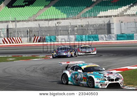SEPANG, MALAYSIA - JUNE 19: The BMW Z4 of GSR&Studie with TeamUKYO accelerates into turn 2 of the Sepang International Circuit in the Japan SUPER GT Round 3 race on June 19, 2011 in Sepang, Malaysia.