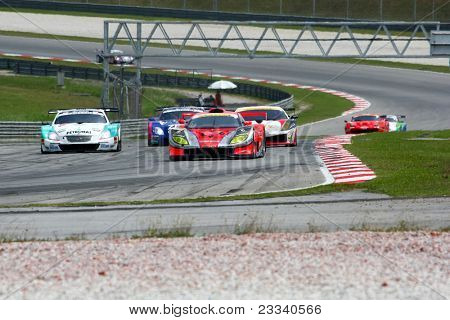 SEPANG, MALAYSIA - JUNE 18: Race cars put in some practice laps at the Sepang International Circuit during the practice sessions of the Japan SUPER GT Round 3 on June 18, 2011 in Sepang, Malaysia.