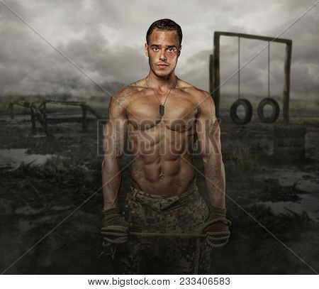 Shirtless Muscular Soldier In A Training Swampland.