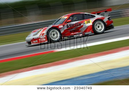 SEPANG, MALAYSIA - JUNE 18: The Porsche car of Team Taisan Cinecitta speeds on the straights of the Sepang International Circuit at the Japan SUPER GT Round 3 on June 18, 2011 in Sepang, Malaysia.