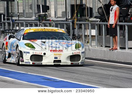 SEPANG - JUNE 18: The Ferrari F430 car of LMP Motorsport leaves the pitlane for practice laps in the Sepang International Circuit at the Japan SUPER GT Round 3 on June 18, 2011 in Sepang, Malaysia.