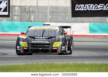 SEPANG, MALAYSIA - JUNE 18: The Toyota Corolla Axio car of 'apr' team puts in some practice laps in the Sepang International Circuit at the Japan SUPER GT Round 3 on June 18, 2011 in Sepang, Malaysia.