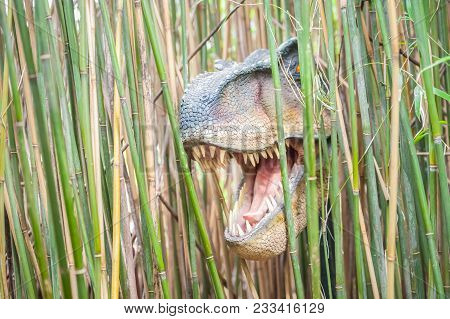 Terrifying Tyrannosaurus Rex Dinosaur Emerging From A Bamboo Forest
