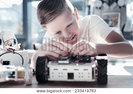 This Is So Interesting. Selective Focus On A Focused Preteen Boy Focusing His Attention On A Robotic
