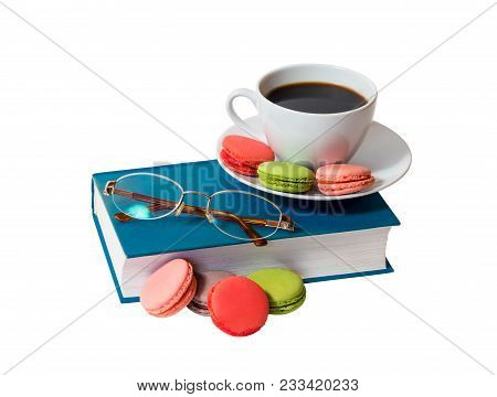 Book, Glasses And White Cup Of Coffee With Macaroons Isolated On White Background