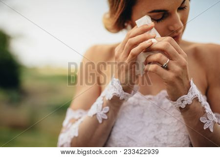 Beautiful Bride In White Dress Weeps Tears Of Happiness On The Wedding Day. Emotional Woman In Weddi