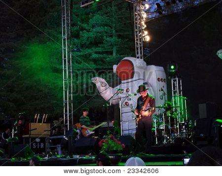 Primus Jams Guitars On Outdoor Stage At Night