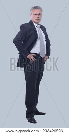 Full length portrait of confident mature businessman in formals