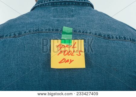 Back View Of Man With Note On Sticky Tape With April Fools Day Lettering On Back, April Fools Day Ho