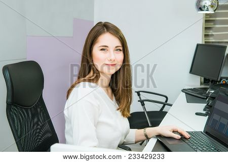 Portrait Of Skilled Administrative Manager Working On Laptop Computer In Office Satisfied With Occup