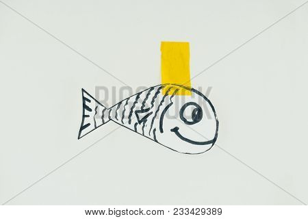Close Up View Of Hand Drawn Fish With Sticky Tape Isolated On Grey, April Fools Day Holiday Concept
