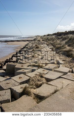 Sea Flood Defence Concrete Blocks Along The East Coast Of England Uk. Barrier Protecting The Cliffs