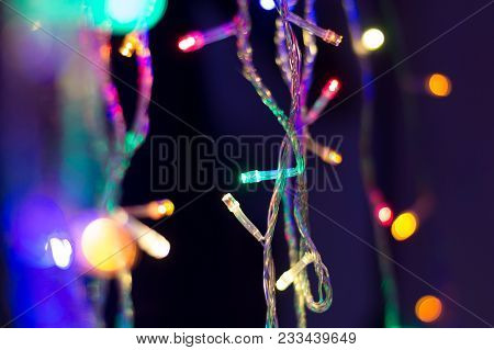 Christmas Fairy Lights, Multi-coloured Fibre Optic Lights With Selective Focus And Bokeh. Dark Backg