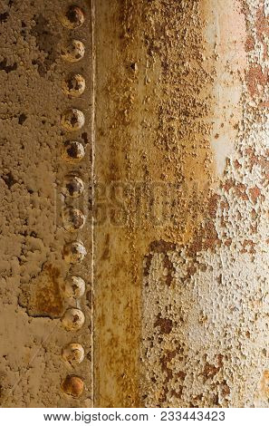 Background of rusty iron surface with rivets