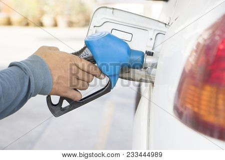 Gas Station. Fuel Pump.colorful Petrol Pump Filling Nozzles.car At Gas Station Being Filled With Fue