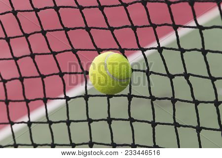 Tennis Ball Hitting The Tennis Net At Tennis Court With Copy Space.