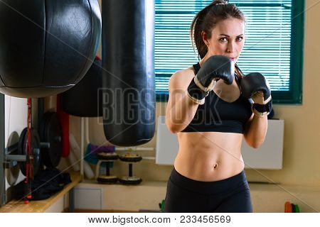 40-year Strong Woman Coaches The Boxer Strikes During Of Workout