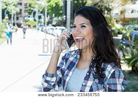 Beautiful Young Woman Talking On Phone In City In The Summer