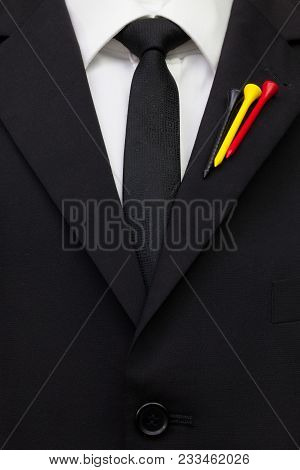 The Detail Of Wedding Suit With Golf Design.golf Tees In The Color Of Belgian Flag On The Flap Of Bl