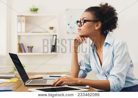 Serious African-american Business Woman Working On Laptop At Office. Businesswoman Typing Something