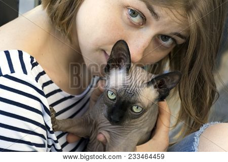 Bald Cat On The Hands Of A Girl In Vest, Girl And Cat Looking Straight, Eyes, Woman, Pet, 2, Two, Br