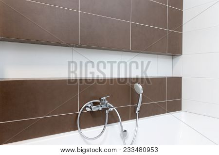 Bathroom Wall In White And Brown Color Design With Niche And Water Supply.