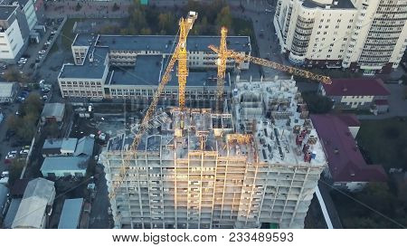 Busy Construction Site And Construction Equipment Aerial. Real Construction Site Industrial Skyscrap