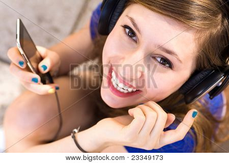 Girl listening tp mp3 player poster