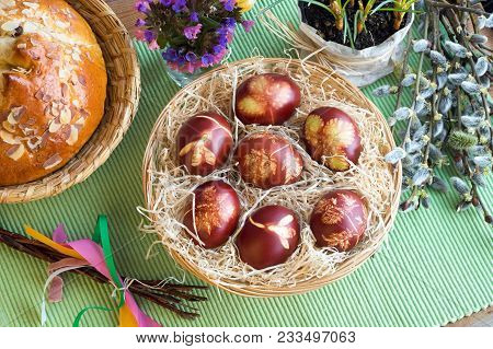 Easter Eggs Dyed With Onion Peels With A Pattern Of Herbs In A Wicker Basket, With Lungwort, Willow