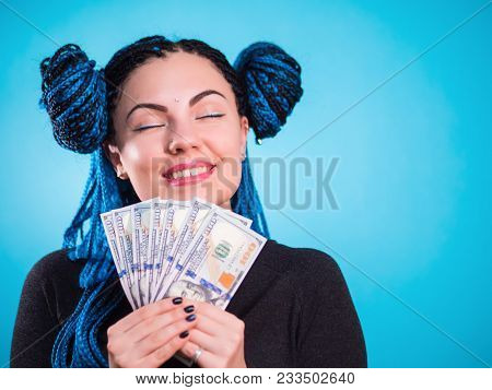 Happy Smiling Woman Holding Cash Money Dollars And Thinking How To Spent Its. Toned Portrait. Hipste