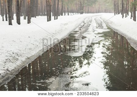 Flooding Of Road Due To Snow Melting  And Rising Of Water Level. Spring Emergency Incident. High Wat