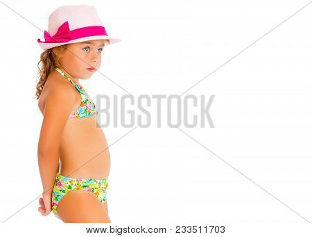 Beautiful Little Tanned Girl In A Swimsuit And A Hat. The Concept Of Summer Family Vacations, Rest O