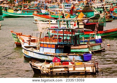 traditional colorful Vietnamese fishing boats in Ben Ngu wharf of Nam Du Islands, Kien Giang, Vietnam. Nam Du has become a popular tourist attraction, but foreigner are only allowed in with a permit.