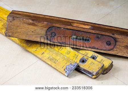 Old Carpentry Tools In A Workshop. Spirit Level In A Wooden Case On A Wooden Table.