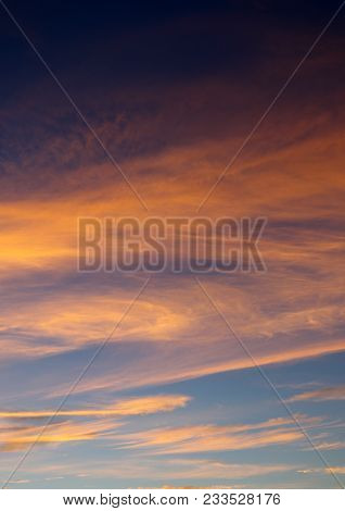 A Pastel, Cloud Filled Sunset Sky In Pinks And Blues.