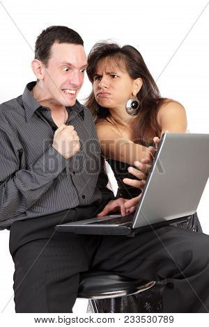 The Guy And Girl With The Laptop Isolated On A White Background