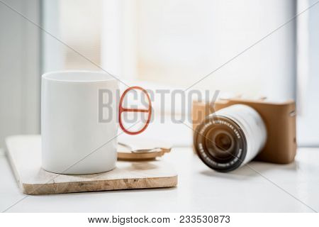 Cup Of Coffee Or Tea  And Classic Camera On White Table