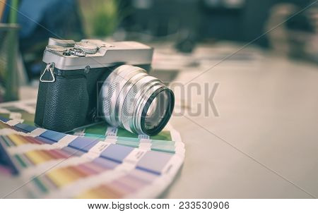 Vitage Digital Camera Put On Color Swatches On An Office Desk