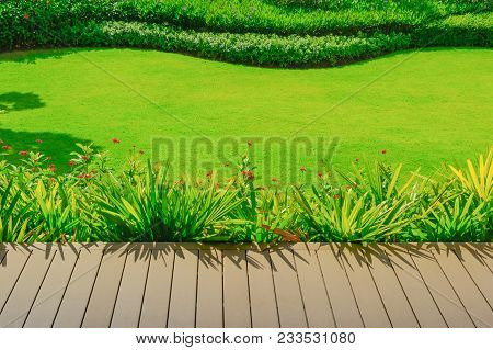 Page Decking Front Lawn, Morning Sunlight Shines On The Front Yard Landscaped Formal Gardens Have Be