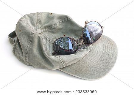 Khaki Green Baseball Hat And Dark Brown Reflective Sunglasses