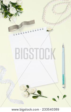 Styled Stock Photo. Feminine Wedding Desktop Mockup. White Roses, Satin Ribbon, Beads On Pastel Gray