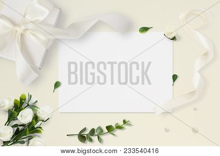 Letter, Envelope And A Present On Pastel Yellow Background. Wedding Invitation Cards Or Love Letter